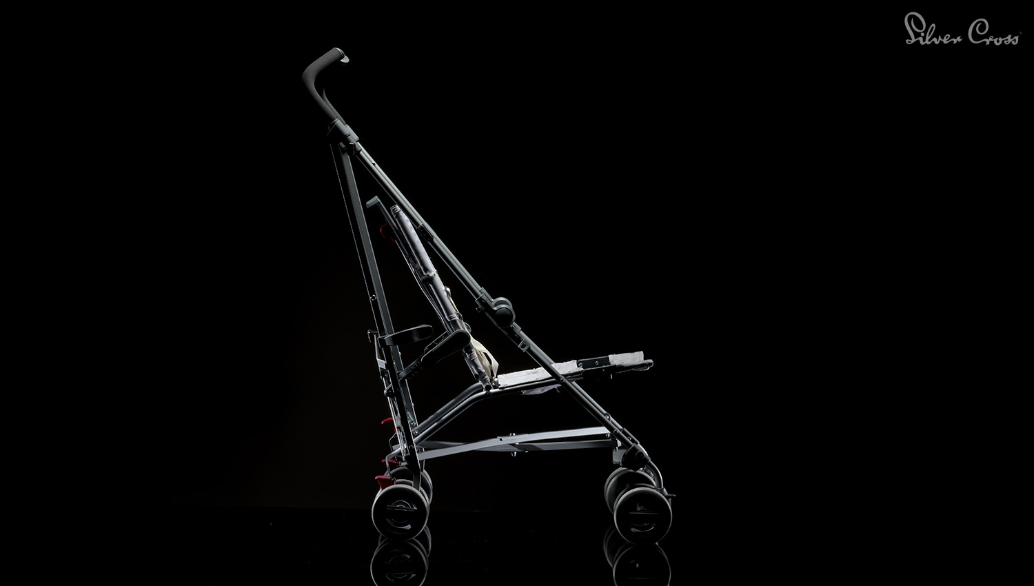 A dramatic use of studio lighting shooting children's product photography and prams for Silver Cross.